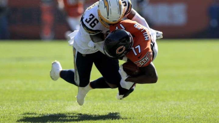 CHICAGO, ILLINOIS - OCTOBER 27: Roderic Teamer #36 of the Los Angeles Chargers tackles Anthony Miller #17 of the Chicago Bears in the second quarter at Soldier Field on October 27, 2019 in Chicago, Illinois. (Photo by Dylan Buell/Getty Images)