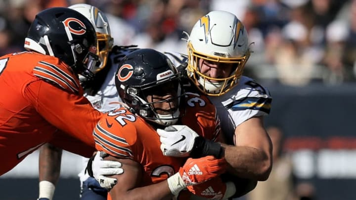CHICAGO, ILLINOIS - OCTOBER 27: David Montgomery #32 of the Chicago Bears runs with the ball while being tackled by Joey Bosa #97 of the Los Angeles Chargers in the fourth quarter at Soldier Field on October 27, 2019 in Chicago, Illinois. (Photo by Dylan Buell/Getty Images)