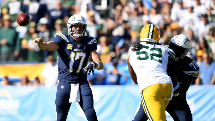CARSON, CALIFORNIA – NOVEMBER 03: Philip Rivers #17 of the Los Angeles Chargers passes as he is rushed by Rashan Gary #52 of the Green Bay Packers in front of Russell Okung #76 during the game at Dignity Health Sports Park on November 03, 2019 in Carson, California. (Photo by Harry How/Getty Images)