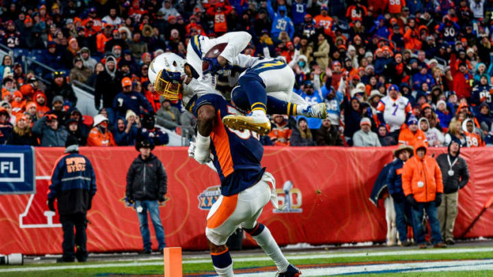DENVER, CO - DECEMBER 1: Keenan Allen #13 of the Los Angeles Chargers leaps over Will Parks #34 of the Denver Broncos to score a third quarter touchdown on a reception at Empower Field at Mile High on December 1, 2019 in Denver, Colorado. (Photo by Dustin Bradford/Getty Images)