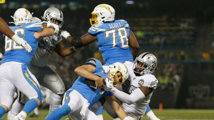 OAKLAND, CALIFORNIA - NOVEMBER 07: Philip Rivers #17 of the Los Angeles Chargers is sacked by Clelin Ferrell #96 of the Oakland Raiders in the second quarter at RingCentral Coliseum on November 07, 2019 in Oakland, California. (Photo by Lachlan Cunningham/Getty Images)