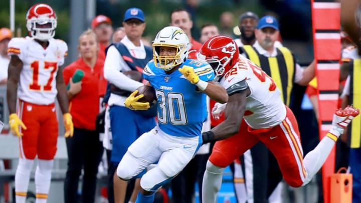 MEXICO CITY, MEXICO - NOVEMBER 18: Running back Austin Ekeler #30 of the Los Angeles Chargers carries the ball against defensive end Tanoh Kpassagnon #92 of the Kansas City Chiefs during the game at Estadio Azteca on November 18, 2019 in Mexico City, Mexico. (Photo by Manuel Velasquez/Getty Images)