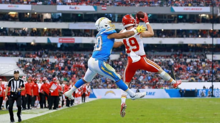 MEXICO CITY, MEXICO - NOVEMBER 18: Defensive back Daniel Sorensen #49 of the Kansas City Chiefs intercepts a pass intended for running back Austin Ekeler #30 of the Los Angeles Chargers in the fourth quarter of the game at Estadio Azteca on November 18, 2019 in Mexico City, Mexico. (Photo by Manuel Velasquez/Getty Images)