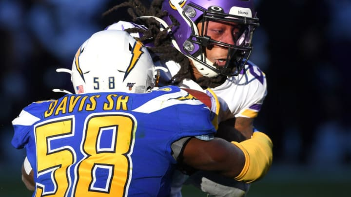 CARSON, CA - DECEMBER 15: Running back Mike Boone #23 of the Minnesota Vikings drags outside linebacker Thomas Davis #58 of the Los Angeles Chargers into the end zone as he goes for a touchdown in the second half of the game at Dignity Health Sports Park on December 15, 2019 in Carson, California. (Photo by Jayne Kamin-Oncea/Getty Images)