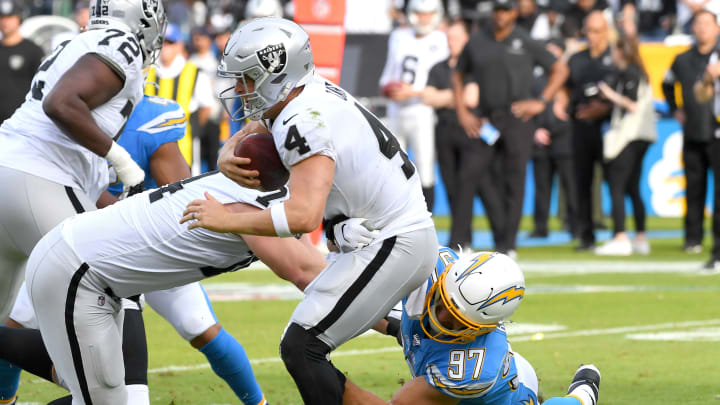 CARSON, CA – DECEMBER 22: Quarterback Derek Carr #4 of the Oakland Raiders is sacked by defensive end Joey Bosa #97 of the Los Angeles Chargers in the first half of the game at Dignity Health Sports Park on December 22, 2019 in Carson, California. (Photo by Jayne Kamin-Oncea/Getty Images)