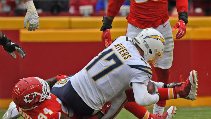 KANSAS CITY, MO – DECEMBER 29: Outside linebacker Terrell Suggs #94 of the Kansas City Chiefs sacks quarterback Philip Rivers #17 of the Los Angeles Chargers during the second half at Arrowhead Stadium on December 29, 2019 in Kansas City, Missouri. (Photo by Peter Aiken/Getty Images)
