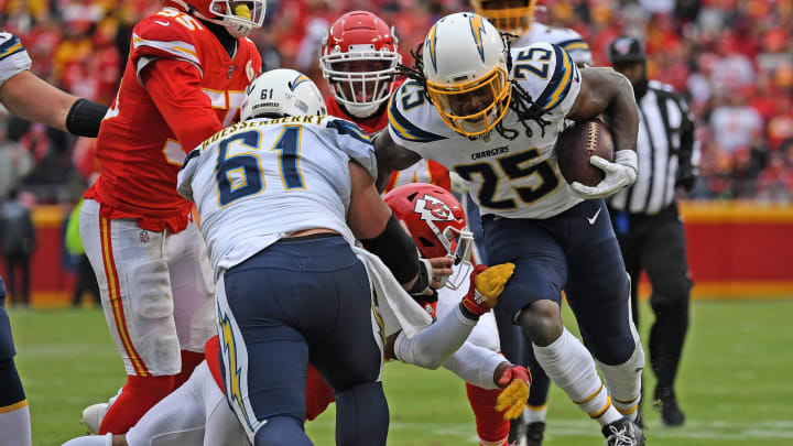 KANSAS CITY, MO – DECEMBER 29: Running back Melvin Gordon #25 of the Los Angeles Chargers runs up field against the Kansas City Chiefs during the second half at Arrowhead Stadium on December 29, 2019 in Kansas City, Missouri. (Photo by Peter Aiken/Getty Images)