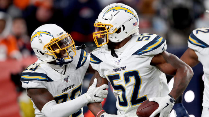 DENVER, COLORADO – DECEMBER 01: Denzel Perryman #52 of the Los Angeles Chargers celebrates with Desmond King II after making an interception against the Denver Broncos in the fourth quarter at Empower Field at Mile High on December 01, 2019 in Denver, Colorado. (Photo by Matthew Stockman/Getty Images)
