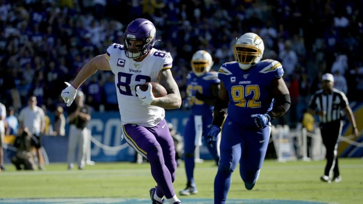 CARSON, CALIFORNIA – DECEMBER 15: Tight end Kyle Rudolph #82 of the Minnesota Vikings is pursued by Brandon Mebane #92 of the Los Angeles Chargers in the first quarter at Dignity Health Sports Park on December 15, 2019, in Carson, California. (Photo by Jeff Gross/Getty Images)