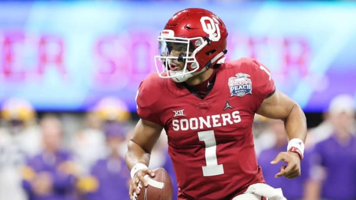 ATLANTA, GEORGIA - DECEMBER 28: Quarterback Jalen Hurts #1 of the Oklahoma Sooners carries the ball against the defense of the LSU Tigers during the Chick-fil-A Peach Bowl at Mercedes-Benz Stadium on December 28, 2019 in Atlanta, Georgia. (Photo by Carmen Mandato/Getty Images)
