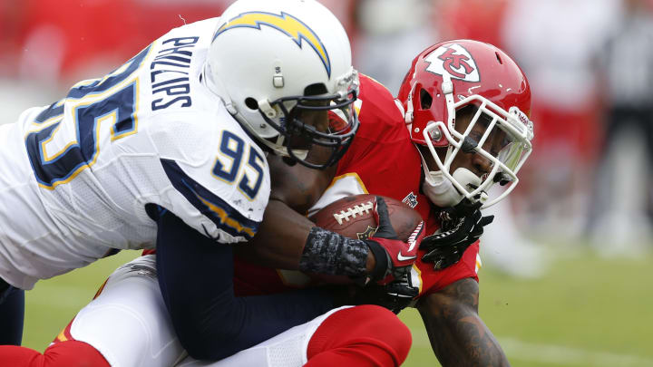 KANSAS CITY, MO – SEPTEMBER 30: Jon Baldwin #89 of the Kansas City Chiefs gets tackled by Shaun Phillips #95 of the San Diego Chargers during the game at Arrowhead Stadium on September 30, 2012, in Kansas City, Missouri. (Photo by Joe Robbins/Getty Images)