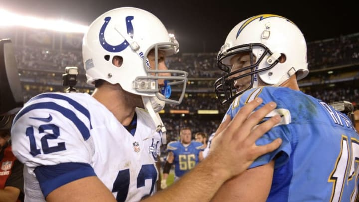 SAN DIEGO, CA - OCTOBER 14: Quarterback Philip Rivers #17 is congratulated by quarterback Andrew Luck #12 of the Indianapolis Colts at the end of the football game at Qualcomm Stadium October 14, 2013 in San Diego, California. (Photo by Kevork Djansezian/Getty Images)