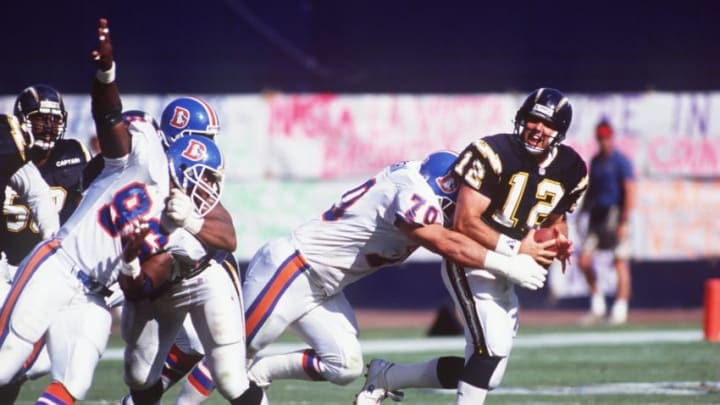 25 Oct 1992: SAN DIEGO CHARGERS QUARTERBACK STAN HUMPHRIES IS SACKED BY BRIAN SOCHIC OF THE MIAMI DOLPHINS.