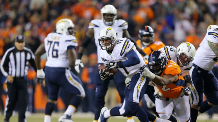 DENVER, CO - DECEMBER 12: Sylvester Williams #92 of the Denver Broncos sacks Philip Rivers #17 of the San Diego Chargers in the first quarter at Sports Authority Field at Mile High on December 12, 2013 in Denver, Colorado. (Photo by Justin Edmonds/Getty Images)