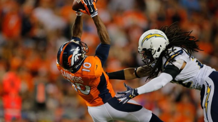 DENVER, CO - OCTOBER 23: Wide receiver Emmanuel Sanders #10 of the Denver Broncos has a second quarter catch as cornerback Jason Verrett #22 of the San Diego Chargers defends during a game at Sports Authority Field at Mile High on October 23, 2014 in Denver, Colorado. (Photo by Doug Pensinger/Getty Images)