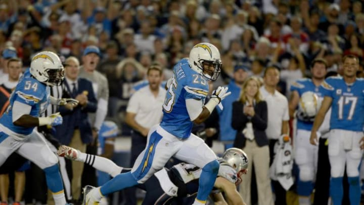 SAN DIEGO, CA- DECEMBER 7: Darrell Stuckey #25 of the San Diego Chargers runs back a fumble recovery for a touchdown against the New England Patriots during an NFL game at Qualcomm Stadium on December 7, 2014 in San Diego, California. (Photo by Donald Miralle/Getty Images)
