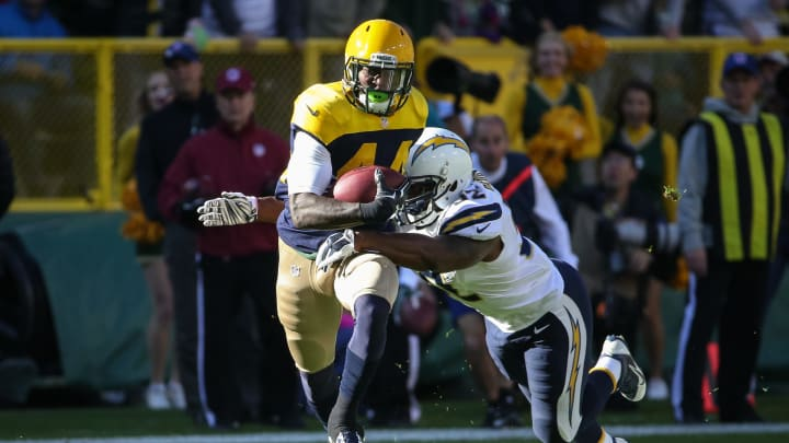 GREEN BAY, WI – OCTOBER 18: James Starks #44 of the Green Bay Packers carries the football against Denzel Perryman #52 of the San Diego Chargers in the first quarter at Lambeau Field on October 18, 2015 in Green Bay, Wisconsin. (Photo by Jonathan Daniel/Getty Images)