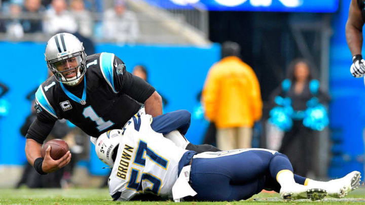 CHARLOTTE, NC - DECEMBER 11: Cam Newton #1 of the Carolina Panthers is tackled by Jatavis Brown #57 of the San Diego Chargers in the 1st quarter during the game at Bank of America Stadium on December 11, 2016 in Charlotte, North Carolina. (Photo by Grant Halverson/Getty Images)