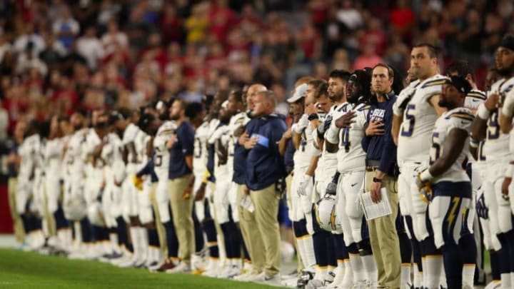 GLENDALE, AZ - AUGUST 11: The Los Angeles Chargers stand attended for the national anthem before the preseason NFL game against the Arizona Cardinals at University of Phoenix Stadium on August 11, 2018 in Glendale, Arizona. (Photo by Christian Petersen/Getty Images)