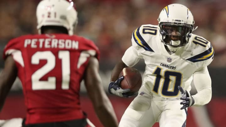 GLENDALE, AZ - AUGUST 11: Wide receiver Artavis Scott #10 of the Los Angeles Chargers rushes the football against defensive back Patrick Peterson #21 of the Arizona Cardinals during the preseason NFL game at University of Phoenix Stadium on August 11, 2018 in Glendale, Arizona. (Photo by Christian Petersen/Getty Images)