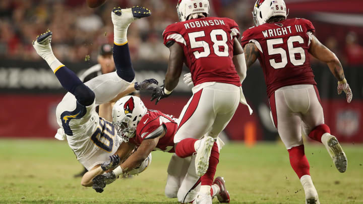 GLENDALE, AZ – AUGUST 11: Defensive back A.J. Howard #42 of the Arizona Cardinals attempts to knock the ball from tight end Sean Culkin #80 of the Los Angeles Chargers during the preseason NFL game at University of Phoenix Stadium on August 11, 2018 in Glendale, Arizona. (Photo by Christian Petersen/Getty Images)