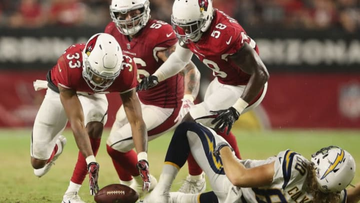 GLENDALE, AZ - AUGUST 11: Defensive back Chris Campbell #33 of the Arizona Cardinals recovers a loose ball during the preseason NFL game against the Los Angeles Chargers at University of Phoenix Stadium on August 11, 2018 in Glendale, Arizona. (Photo by Christian Petersen/Getty Images)