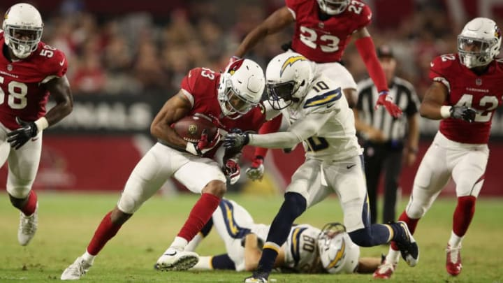 GLENDALE, AZ - AUGUST 11: Defensive back Chris Campbell #33 of the Arizona Cardinals recovers a loose ball against wide receiver Artavis Scott #10 of the Los Angeles Chargers during the preseason NFL game at University of Phoenix Stadium on August 11, 2018 in Glendale, Arizona. (Photo by Christian Petersen/Getty Images)
