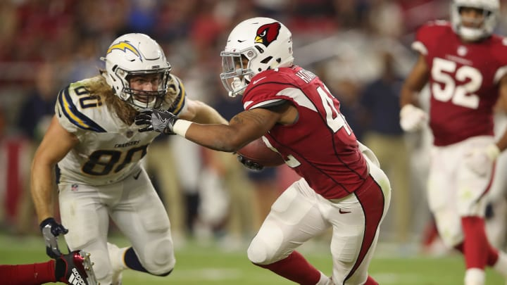 GLENDALE, AZ – AUGUST 11: Defensive back A.J. Howard #42 of the Arizona Cardinals return a fumble against tight end Sean Culkin #80 of the Los Angeles Chargers during the preseason NFL game at University of Phoenix Stadium on August 11, 2018 in Glendale, Arizona. (Photo by Christian Petersen/Getty Images)