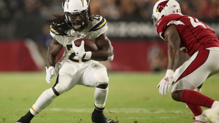 GLENDALE, AZ - AUGUST 11: Running back Melvin Gordon #28 of the Los Angeles Chargers rushes the football against the Arizona Cardinals during the preseason NFL game at University of Phoenix Stadium on August 11, 2018 in Glendale, Arizona. (Photo by Christian Petersen/Getty Images)