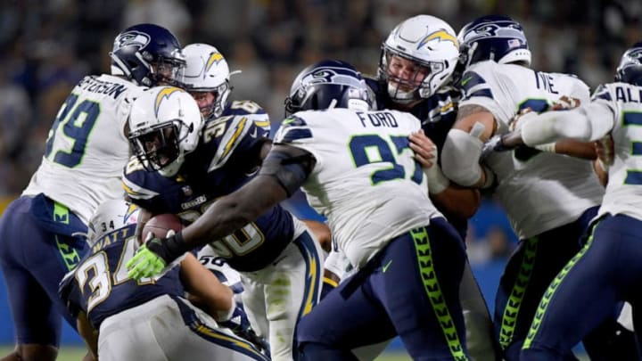 CARSON, CA - AUGUST 18: Detrez Newsome #38 of the Los Angeles Chargers carries the ball as he is chased by Poona Ford #97 of the Seattle Seahawks during a 24-14 presseason Charger win at StubHub Center on August 18, 2018 in Carson, California. Photo by Harry How/Getty Images