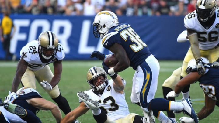 CARSON, CA - AUGUST 25: Detrez Newsome #38 of the Los Angeles Chargers gets past A.J. Klein #53 of the New Orleans Saints for a gain in the second quarter of the pre-season game at StubHub Center on August 25, 2018 in Carson, California. (Photo by Jayne Kamin-Oncea/Getty Images)