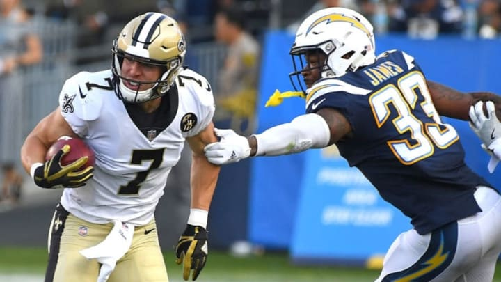 CARSON, CA - AUGUST 25: Derwin James #33 of the Los Angeles Chargers reaches for Taysom Hill #7 of the New Orleans Saints after he fakes a punt and runs for a first down in the first quarter of the pre-season game at StubHub Center on August 25, 2018 in Carson, California. (Photo by Jayne Kamin-Oncea/Getty Images)