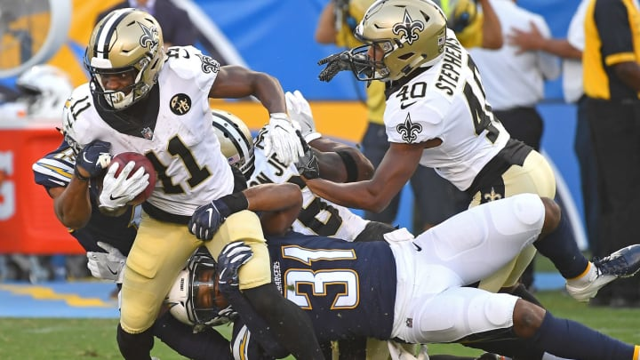 CARSON, CA – AUGUST 25: Tommylee Lewis #11 of the New Orleans Saints breaks a tackle from Adrian Phillips #31 of the Los Angeles Chargers in the third quarter of the preseason game at StubHub Center on August 25, 2018 in Carson, California. (Photo by Jayne Kamin-Oncea/Getty Images)