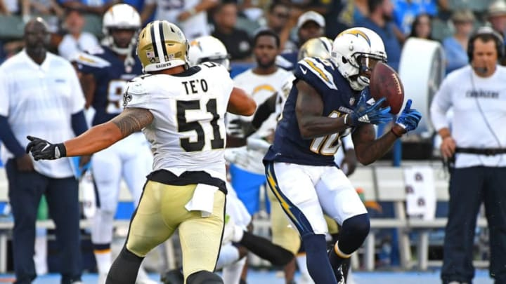 CARSON, CA - AUGUST 25: Manti Te'o #51 of the New Orleans Saints defends as Artavis Scott #10 of the Los Angeles Chargers hangs on to a pass in the second half of the preseason game at StubHub Center on August 25, 2018 in Carson, California. (Photo by Jayne Kamin-Oncea/Getty Images)