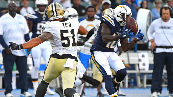 CARSON, CA – AUGUST 25: Manti Te'o #51 of the New Orleans Saints defends as Artavis Scott #10 of the Los Angeles Chargers hangs on to a pass in the second half of the preseason game at StubHub Center on August 25, 2018 in Carson, California. (Photo by Jayne Kamin-Oncea/Getty Images)