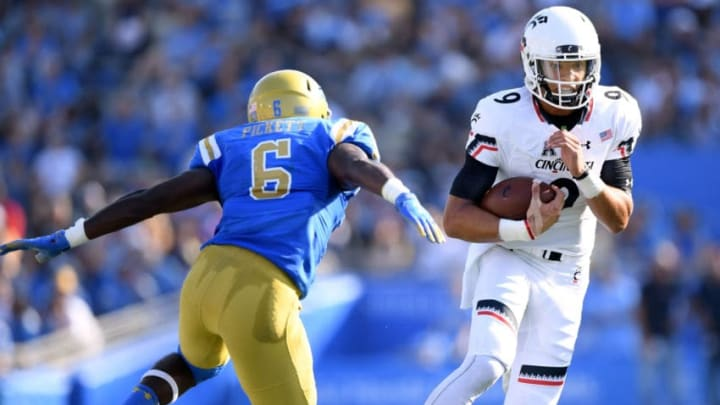 PASADENA, CA - SEPTEMBER 01: Desmond Ridder #9 of the Cincinnati Bearcats scrambles out of the pocket in front of Adarius Pickett #6 of the UCLA Bruins during the second quarter at Rose Bowl on September 1, 2018 in Pasadena, California. (Photo by Harry How/Getty Images)