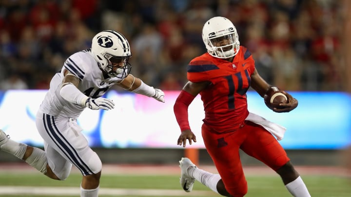 TUCSON, AZ – SEPTEMBER 01: Quarterback Khalil Tate #14 of the Arizona Wildcats scrambles with the football past linebacker Sione Takitaki #16 of the Brigham Young Cougars during the first half of the college football game at Arizona Stadium on September 1, 2018, in Tucson, Arizona. (Photo by Christian Petersen/Getty Images)
