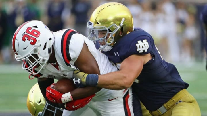 SOUTH BEND, IN - SEPTEMBER 08: Drue Tranquill #23 of the Notre Dame Fighting Irish brings down Caleb Huntley #36 of the Ball State Cardinals at Notre Dame Stadium on September 8, 2018 in South Bend, Indiana. Notre Dame defeated Ball State 24-16.(Photo by Jonathan Daniel/Getty Images)