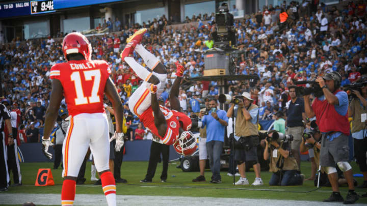 CARSON, CA - SEPTEMBER 09: Wide receiver Tyreek Hill #10 of the Kansas City Chiefs celebrates a touchdown with wide receiver Chris Conley #17 after scoring to lead 38-20 in the fourth quarter against the Los Angeles Chargers at StubHub Center on September 9, 2018 in Carson, California. (Photo by Harry How/Getty Images)