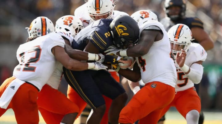 BERKELEY, CA - SEPTEMBER 15: Jordan Duncan #2 of the California Golden Bears is group tackled by the Idaho State Bengals at California Memorial Stadium on September 15, 2018 in Berkeley, California. (Photo by Ezra Shaw/Getty Images)