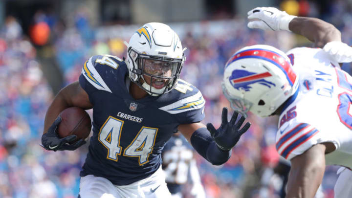 BUFFALO, NY - SEPTEMBER 16: Kyzir White #44 of the Los Angeles Chargers runs the ball back after making an interception during NFL game action against the Buffalo Bills at New Era Field on September 16, 2018 in Buffalo, New York. (Photo by Tom Szczerbowski/Getty Images)