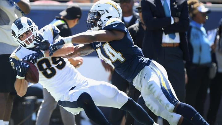 LOS ANGELES, CA – SEPTEMBER 23: Tyler Higbee #89 of the Los Angeles Rams makes a catch for a first down in front of Kyzir White #44 of the Los Angeles Chargers during the second quarter of the game at Los Angeles Memorial Coliseum on September 23, 2018 in Los Angeles, California. (Photo by Harry How/Getty Images)