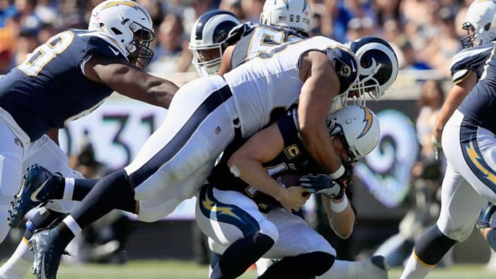 LOS ANGELES, CA - SEPTEMBER 23: Quarterback Philip Rivers #17 of the Los Angeles Chargers gets sacked during the third quarter of the game against the Los Angeles Rams at Los Angeles Memorial Coliseum on September 23, 2018 in Los Angeles, California. (Photo by Sean M. Haffey/Getty Images)