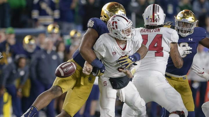 SOUTH BEND, IN – SEPTEMBER 29: K.J. Costello #3 of the Stanford Cardinal is sacked by Jerry Tillery #99 of the Notre Dame Fighting Irish during the game at Notre Dame Stadium on September 29, 2018 in South Bend, Indiana. (Photo by Michael Hickey/Getty Images)