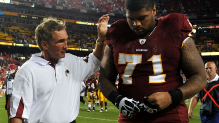 LANDOVER - SEPTEMBER 19: Trent Williams #71 of the Washington Redskins is consoled by head coach Mike Shanahan during the game against the Houston Texans at FedExField on September 19, 2010 in Landover, Maryland. The Texans defeated the Redskins in overtime 30-27. (Photo by Larry French/Getty Images)