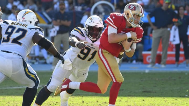 CARSON, CA - SEPTEMBER 30: Quarterback C.J. Beathard #3 of the San Francisco 49ers runs the ball before he is stopped by defensive tackle Justin Jones #91 of the Los Angeles Chargers in the fourth quarter of the game at StubHub Center on September 30, 2018 in Carson, California. (Photo by Jayne Kamin-Oncea/Getty Images)