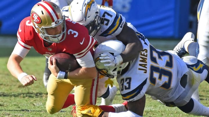 CARSON, CA - SEPTEMBER 30: Quarterback C.J. Beathard #3 of the San Francisco 49ers runs the ball before he is stopped by defensive back Jahleel Addae #37 and defensive back Derwin James #33 of the Los Angeles Chargers in the fourth quarter of the game at StubHub Center on September 30, 2018 in Carson, California. (Photo by Jayne Kamin-Oncea/Getty Images)