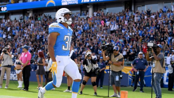 CARSON, CA - OCTOBER 07: Austin Ekeler #30 of the Los Angeles Chargers reacts to his touchdown, to take a 10-3 lead over the Oakland Raiders, during the second quarter at StubHub Center on October 7, 2018 in Carson, California. (Photo by Harry How/Getty Images)