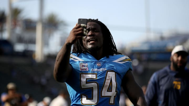CARSON, CA - OCTOBER 07: Melvin Ingram #54 of the Los Angeles Chargers talks on his phone as he leaves the field after defeating the Oakland Raiders 26-10 in a game at StubHub Center on October 7, 2018 in Carson, California. (Photo by Sean M. Haffey/Getty Images)