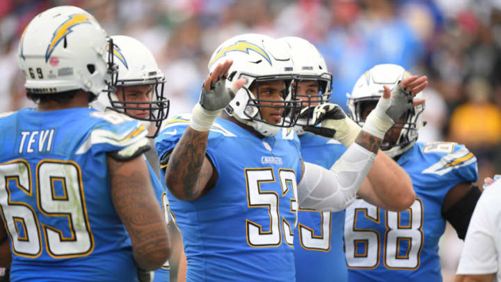 CARSON, CA - OCTOBER 07: Center Mike Pouncey #53 of the Los Angeles Chargers plays to the crowd in the third quarter at StubHub Center on October 7, 2018 in Carson, California. (Photo by Harry How/Getty Images)